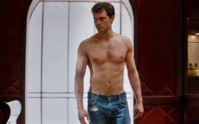 christian-grey-ripped-jeans